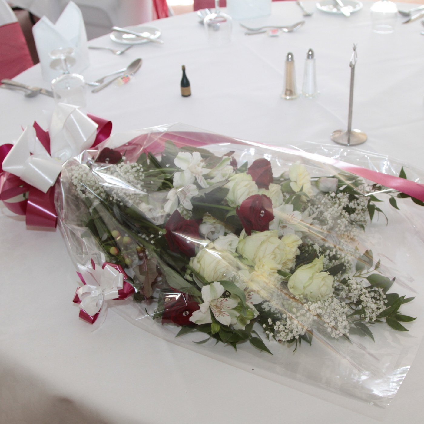 Wrapped bouquet bWrapped bouquet by Exeter florists Buds2Blossomy Exeter florists Buds2Blossom